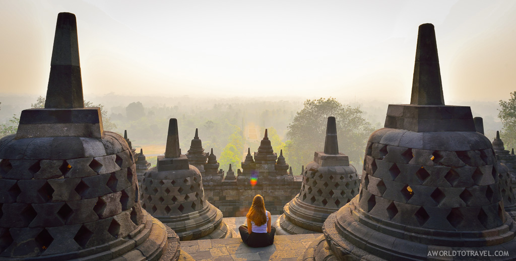 Girl overlooking Borobudur Temple at sunrise - Indonesia - A World to Travel